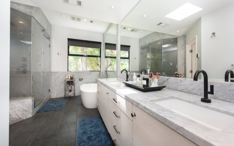 the-master-bath-includes-a-marble-lined-steam-shower-as-well-as-a-separate-soaking-tub